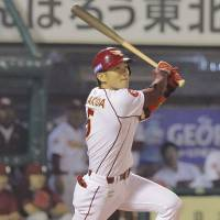 Birthday bash: The Eagles' Akihisa Makida hits a game-winning two-run double in the ninth inning on his 32nd birthday on Tuesday as Tohoku Rakuten defeated the Hanshin Tigers 4-3. | KYODO