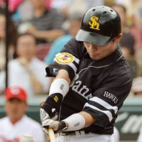 Hit parade: The Hawks' Akira Nakamura connects for a three-run double in the first inning against the Carp on Saturday at Mazda Stadium. Fukuoka Softbank banged out 21 hits in a 16-5 rout over Hiroshima. | KYODO