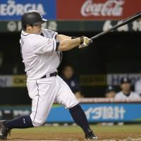 Milestone: Seibu's Takeya Nakamura hits a home run — the 250th of his career — in the sixth inning of the Lions' 7-0 win over the Carp on Friday. | KYODO