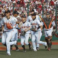 Group effort: The Giants staged a comeback in the ninth inning against the Eagles at Kobo Stadium in Sendai on Sunday. Yomiuri defeated Tohoku Rakuten 3-2.  | KYODO