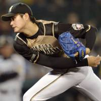 Star in the making: Fighters starter Shohei Otani pitches against the Tigers on Wednesday at Koshien Stadium. Hokkaido Nippon Ham won 4-0. | KYODO