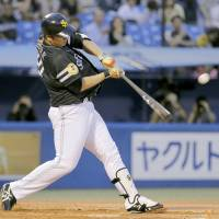 The start of something big: Hawks slugger Lee Dae-ho hits a solo home run in the third inning to break a scoreless tie against the Swallows on Thursday at Jingu Stadium. Fukuoka Softbank routed Tokyo Yakult 7-2. | KYODO