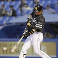 Hit parade: The Hawks' Yuya Hasegawa raps out a hit in the third inning against the Swallows on Friday at Jingu Stadium. Fukuoka Softbank scored seven runs in the third in a 9-6 win over Tokyo Yakult.  | KYODO