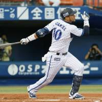 Significant play: BayStars slugger Yulieski Gurriel hits a first-inning sacrifice fly against the Fighters on Thursday at Yokohama Stadium. Yokohama defeated Hokkaido Nippon Ham 2-1. | KYODO