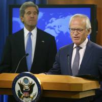 Secretary of State John Kerry listens as Martin Indyk speaks at the State Department in Washington on July 29, 2013. The U.S. special Mideast envoy is resigning after nearly a year of unsuccessful efforts to forge an Israeli-Palestinian peace deal, Obama administration officials said Friday. | AP