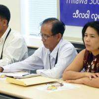 Myanmar villager Khine Win (left) speaks at a Tokyo press conference on Monday. | KYODO