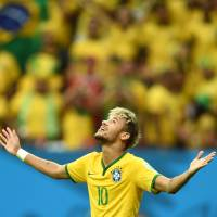 This is my time: Brazil's Neymar looks to the sky after scoring against Cameroon on Monday at the World Cup. | AFP-JIJI