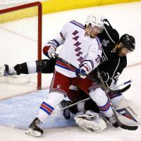 Right behind you: Los Angeles' Dwight King (right) scores as New York's Ryan McDonagh tries to defend in the third period of the Kings' 4-3 win in Game 2 of the Stanley Cup finals on Saturday. | REUTERS