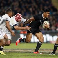 Moving along: New Zealand's Malakai Fekitoa (center) breaks England's line during their first rugby test match at Eden Park in Auckland on Saturday. | REUTERS