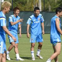 Light-hearted moment: Japan soccer players (from left) Keisuke Honda, Yoichiro Kakitani, Yasuyuki Konno and Shinji Kagawa smile during a team practice on Thursday in Clearwater, Florida. Japan faces Zambia in its final World Cup tune-up match on Friday. | KYODO