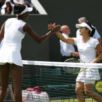 Well played: Kurumi Nara (right) shakes hands with Venus Williams after their second-round match at Wimbledon on Wednesday. Williams won 7-6 (7-4), 6-1. | KYODO