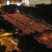 Tens of thousands of people attend a candlelight vigil at Victoria Park in Hong Kong on Wednesday, to mark the 25th anniversary of the Tiananmen Massacre. | AP