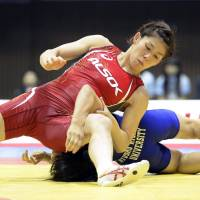 Victorious effort: Three-time Olympic gold medalist Saori Yoshida grabs the 53-kg division title at the National Invitational Championships on Sunday in Tokyo.  | KYODO