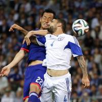 Home and away: Southampton defender Maya Yoshida is hoping Japan can play England in the second round of the World Cup in Brazil. | REUTERS