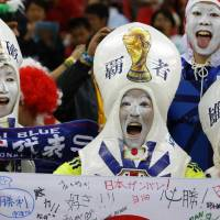 Japanese fans show their support during their team's 2014 World Cup Group C soccer match against Cote d'Ivoire at the Pernambuco arena in Recife, Brazil. | REUTERS