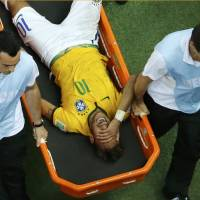 Brazil's Neymar grimaces as he is stretchered off the pitch in the closing minutes of Friday's match against Colombia at the Castelao arena in Fortaleza. | REUTERS
