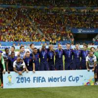 Netherlands players pose with their medals after defeating Brazil in the third-place playoff on Saturday at the Brasilia national stadium in Brasilia    REUTERS