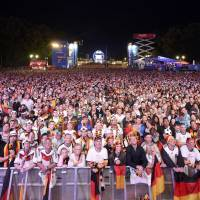 Fans watch Sunday's final between Germany and Argentina at a public screening in Berlin.