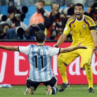 Maxi Rodriguez celebrates with goalkeeper Sergio Romero after scoring the decisive goal as Argentina edged the Netherlands 4-2 on penalties in Wednesday's semifinal match at the Itaquerao Stadium in Sao Paulo.