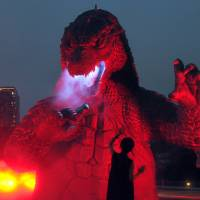 "A 6.6-meter high model of Godzilla is illuminated Thursday at Tokyo Midtown's garden in the Roppongi district to commemorate the 60th anniversary of the first ""Godzilla'' movie in 1954.  