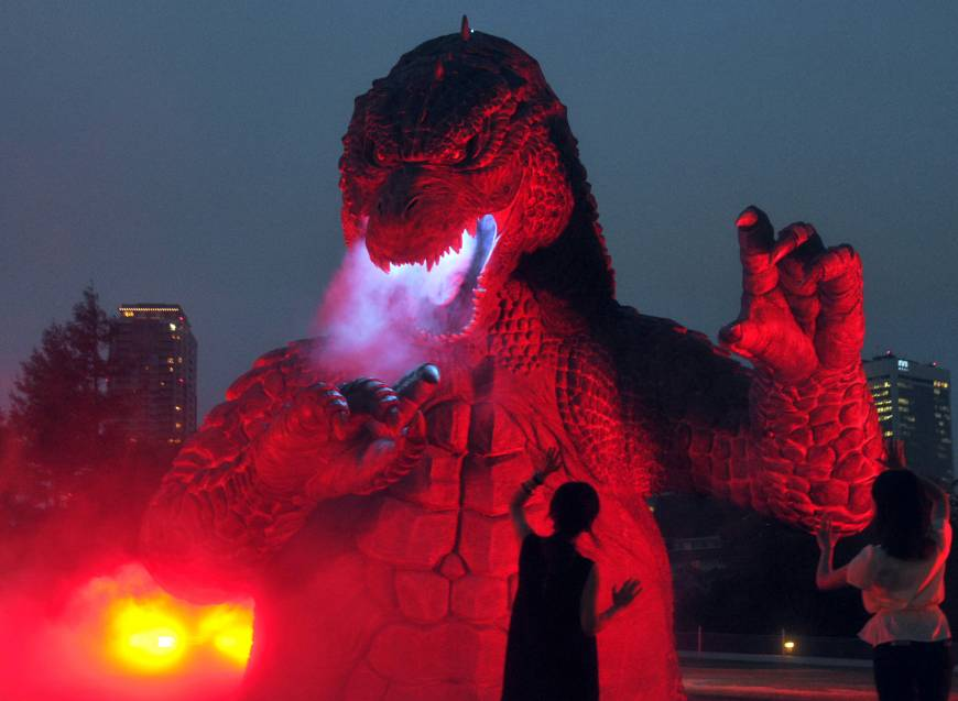 "A 6.6-meter high model of Godzilla is illuminated Thursday at Tokyo Midtown's garden in the Roppongi district to commemorate the 60th anniversary of the first ""Godzilla'' movie in 1954."