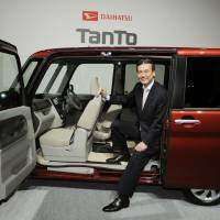 Daihatsu Motor Co. President Masanori Mitsui, at the launch of the revamped Daihatsu Tanto in Tokyo in October. | KYODO