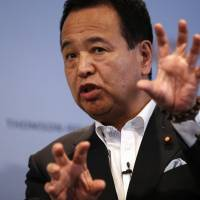 Economics minister Akira Amari told reporters in Tokyo on Friday that TPP is central to Abenomics. | REUTERS