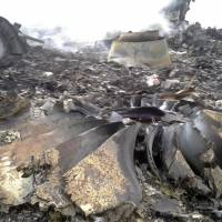 The site of a Malaysia Airlines Boeing 777 plane crash is seen Thursday at the settlement of Grabovo in the Donetsk region. | REUTERS
