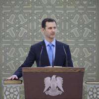 Assad says the push to topple him is tenuous after he is sworn in for a third term as Syrian president