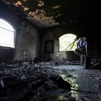 A Libyan investigates inside the U.S. Consulate in Benghazi on Sept. 13, 2012, two days after it was hit by what military officers indicated may have been a two-pronged attack. | AP