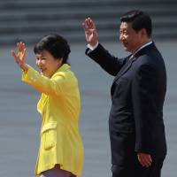 South Korean President Park Geun-hye is escorted by Chinese President Xi Jinping during a welcoming ceremony outside the Great Hall of the People in Beijing on June 27. | AP