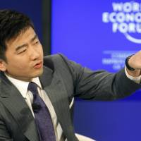 Rui Chenggang, director and anchor of China Central Television, moderates a session at the World Economic Forum in Davos, Switzerland, in January 2011. The top business journalist at China's state broadcaster was taken away by prosecutors, the Chinese financial news magazine Caixin reported Saturday on its website. | AP