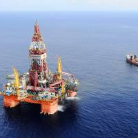 The Haiyang Shiyou 981 oil rig, the first deep-water drilling rig developed in China, lies 320 km southeast of Hong Kong in the South China Sea on May 7. China moved the rig Wednesday following deadly protests in Vietnam. | AP