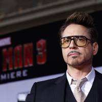 Cast member Robert Downey Jr. poses at the premiere of 'Iron Man 3' at the El Capitan theater in Hollywood, California, on April 24, 2013, The star of Disney's Marvel superhero film franchises 'Iron Man' and 'The Avengers' is Hollywood's highest-paid actor for the second consecutive year, with estimated earnings of $75 million, Forbes.com, said Monday. | REUTERS