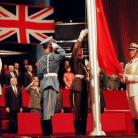 The Chinese flag is raised by People's Liberation Army soldiers at the handover ceremony in Hong Kong on July 1, 1997. Hong Kong returned to Chinese sovereignty after 156 years of British colonial rule 17 years ago today. | REUTERS