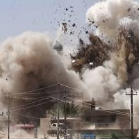 The Shiite Al-Qubba Husseiniya mosque is blown up in Mosul, Iraq, in this photo posted on a militant website. | AP