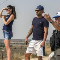 Israelis watch the fighting between the army and Palestinian militants on Saturday. | AFP