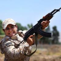 A woman from an elite unit of female Kurdish Peshmerga fighters trains in Sulaimaniyah, 160 miles (260 km) northeast of Baghdad, on July 3. Some Kurdish women living in northern Iraq are training to be Peshmerga, as the self-ruled Kurdish region's militia is known, to fight against the imminent threat of Islamic militants and to protect their land. | AP