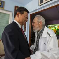Cuba's Fidel Castro speaks with Chinese President Xi Jinping in Havana on Tuesday. Xi Jinping said that his state visit to Cuba is aimed at carrying forward the traditional friendship between the two countries jointly built by Castro and the older generations of Chinese leaders, so as to inject new impetus into bilateral cooperation. He also extended good wishes to Castro for his upcoming 88th birthday. | AP