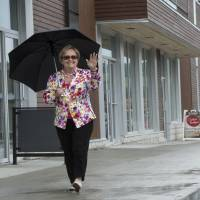Mayor Colette Roy Laroche walks along the street of the new downtown core of Lac-Megantic on June 10. | AP