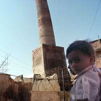 Fear, anger and sadness were palpable across Mosul on Saturday as rumors that Islamic State militants who had purged Iraq's second city of some of its most cherished landmarks were eyeing the Crooked Minaret, al-Manara al-Hadba in Arabic, seen in this file photo from 1998 — as their next target. The 842-year old tower, which leans like Italy's Tower of Pisa, is one of the country's most famous structures, and can be found on the Iraqi 10,000-dinar bill. | AP