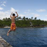 A boy jumps from a wharf in Alofi, Niue. | AP