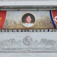 Military personnel salute a portrait of North Korean leader Kim Jong Un during an event at the plaza of the Kumsusan Palace of the Sun to mark the 61st anniversary of the armistice that ended the Korean War taken on Sunday. | REUTERS