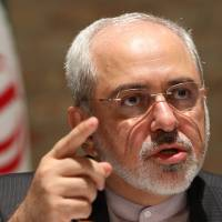 Iranian Foreign Minister Mohammad Javad Zarif speaks to the media after closed-door nuclear talks on Iran took place in Vienna on Tuesday. | AP
