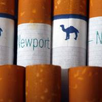 Reynolds American's Camel brand cigarettes and Lorillard's Newport cigarettes are arranged for a photo in Philadelphia on Tuesday after the two companies announced that Reynolds plans to buy Lorillard for about $25 billion, combining two of America's biggest tobacco companies. | AP