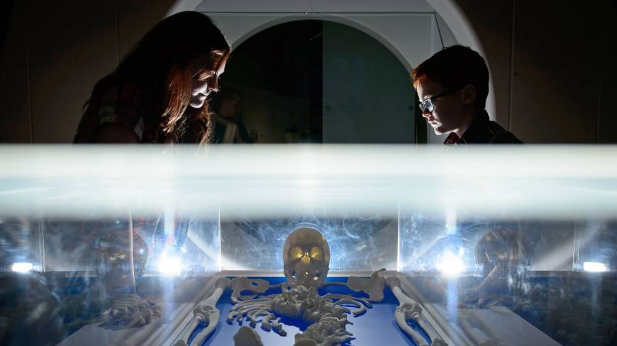 Visitors look a replica skeleton of King Richard III on Thursday displayed at the new visitor center on the site in the city of Leicester where his remains were discovered in 2012.