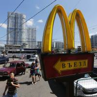 A McDonald's logo adorns a restaurant on the outskirts of Moscow on Friday. Russia's consumer protection agency has filed a lawsuit in a local court seeking to ban some of McDonald's burgers and other offerings. | REUTERS