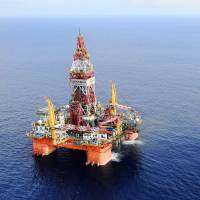 China's Haiyang Shiyou oil rig 981, the first deep-water drilling rig developed in the country, is pictured at 320 km southeast of Hong Kong in the South China Sea in May 2012. China on Wednesday moved an oil rig that it had deployed in a section of the South China Sea, triggering a dispute with Vietnam. Beijing deployed the massive rig in early May close to the Paracel Islands, triggering a furious reaction in Hanoi and the most serious uptick in tensions in the waters in years.   AP