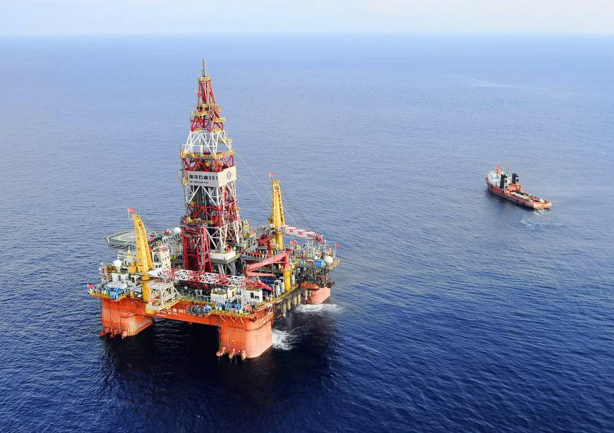 China removes oil rig that triggered Vietnam riots from disputed waters