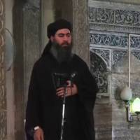 A man purported to be the reclusive leader of the Islamic State, Abu Bakr al-Baghdadi, speaks to followers during a sermon in the center of Iraq's second city, Mosul, according to a video recording posted on the Internet on Saturday. Speaking in classical Arabic, and with little emotion, al-Baghdadi called on Muslims to obey him, and described leadership as a 'burden.'   REUTERS